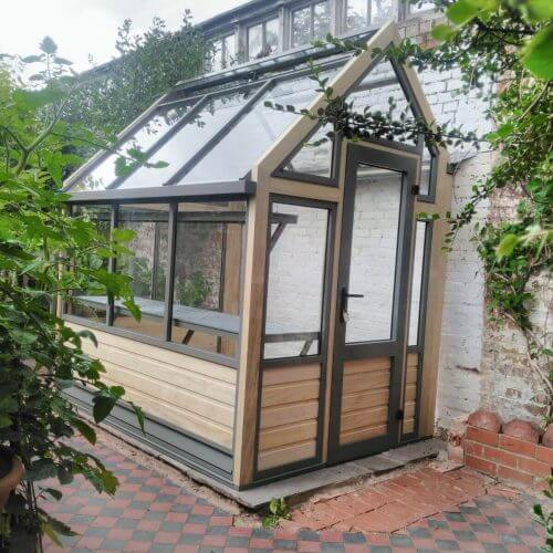 narrow greenhouse against wall