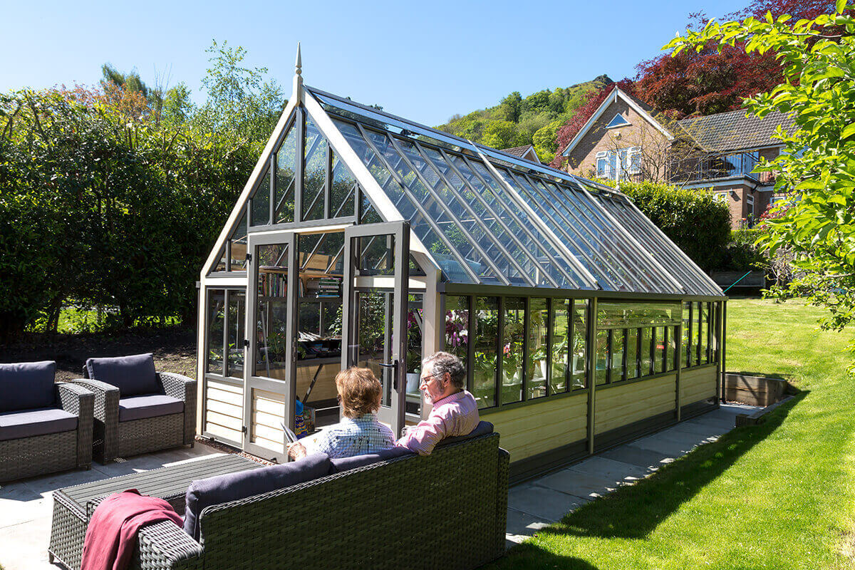 A seating area in front of Victorian greenhouse