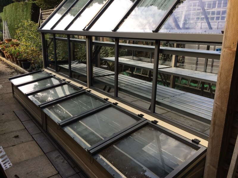Cold frames on greenhouse