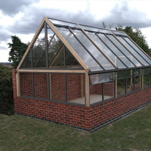 greenhouse against a wall