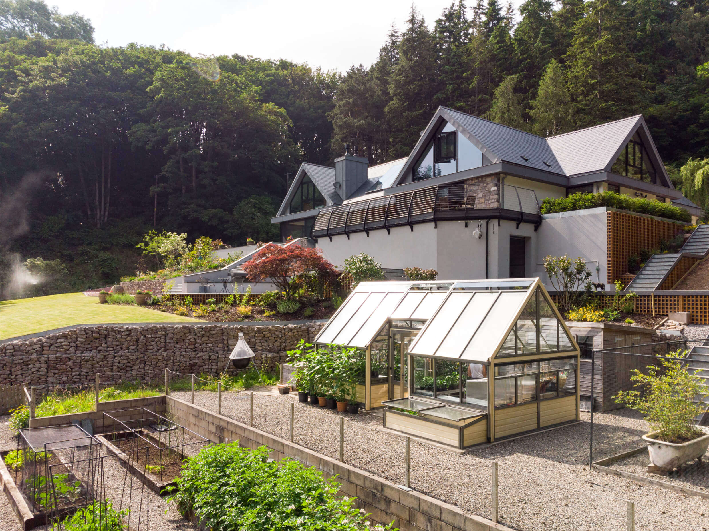 cultivar greenhouse in front of newbuild house