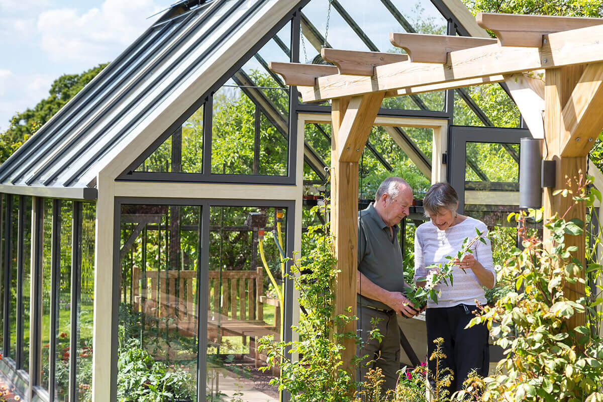 Customers outside large greenhouse
