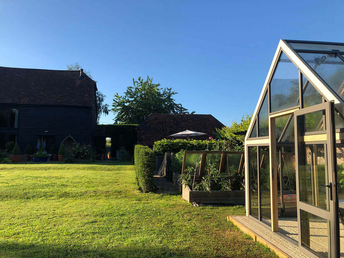 Greenhouse in barn courtyard
