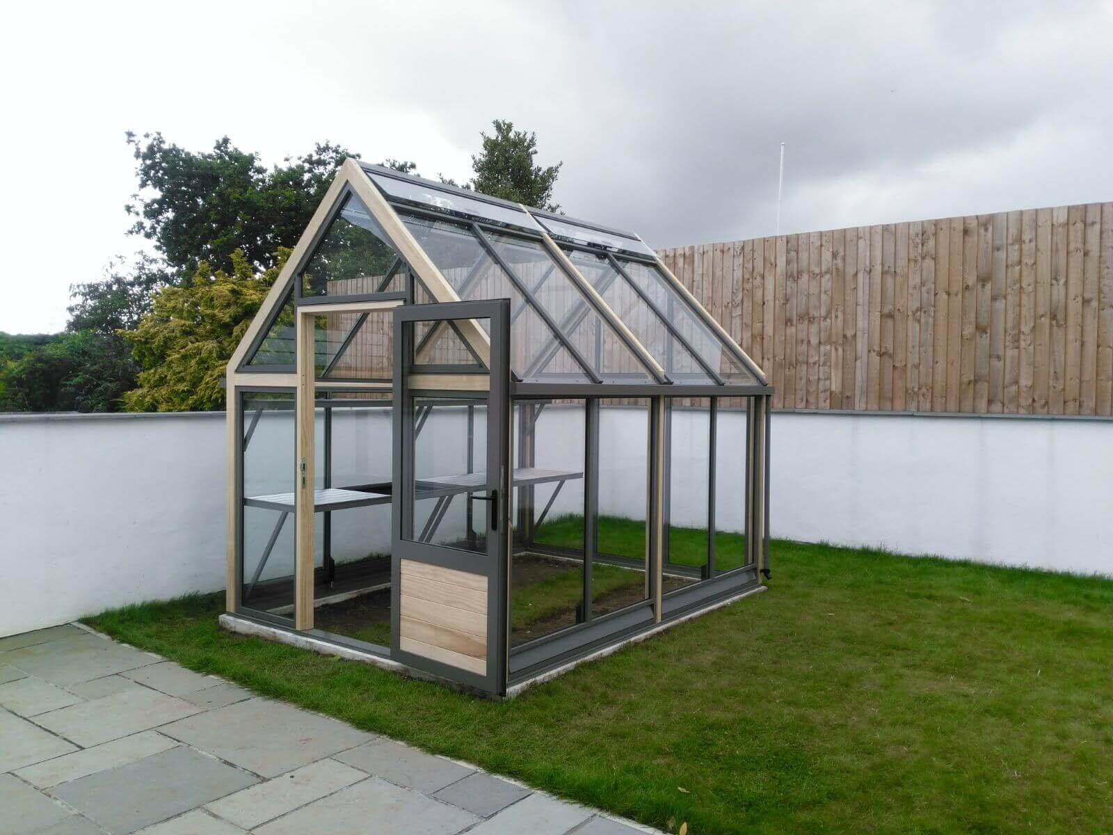 New Greenhouse in a modern garden setting