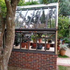 Small greenhouse on wall, Victorian Greenhouse