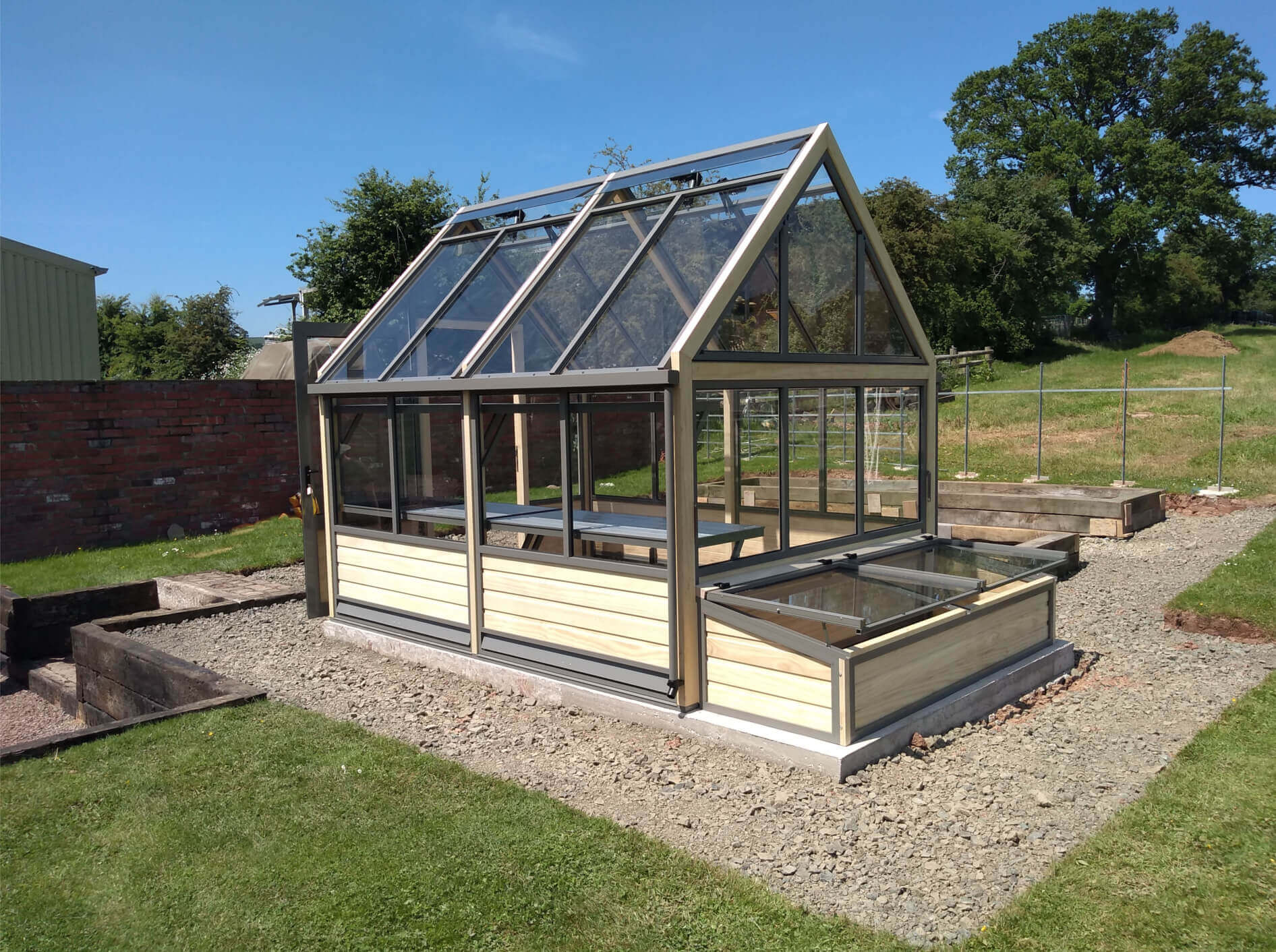 wooden greenhouse and coldframes