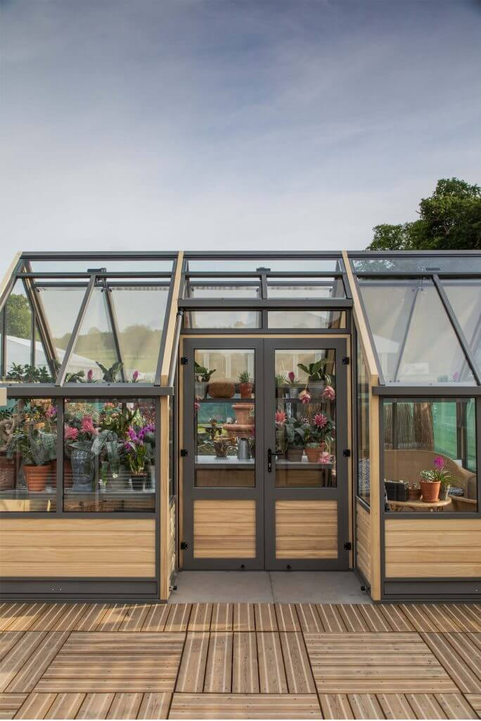 view of a large greenhouse with double doors access in the side.