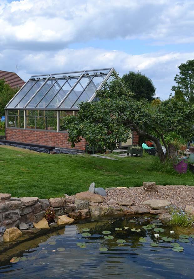 Large greenhouse on dwarf wall