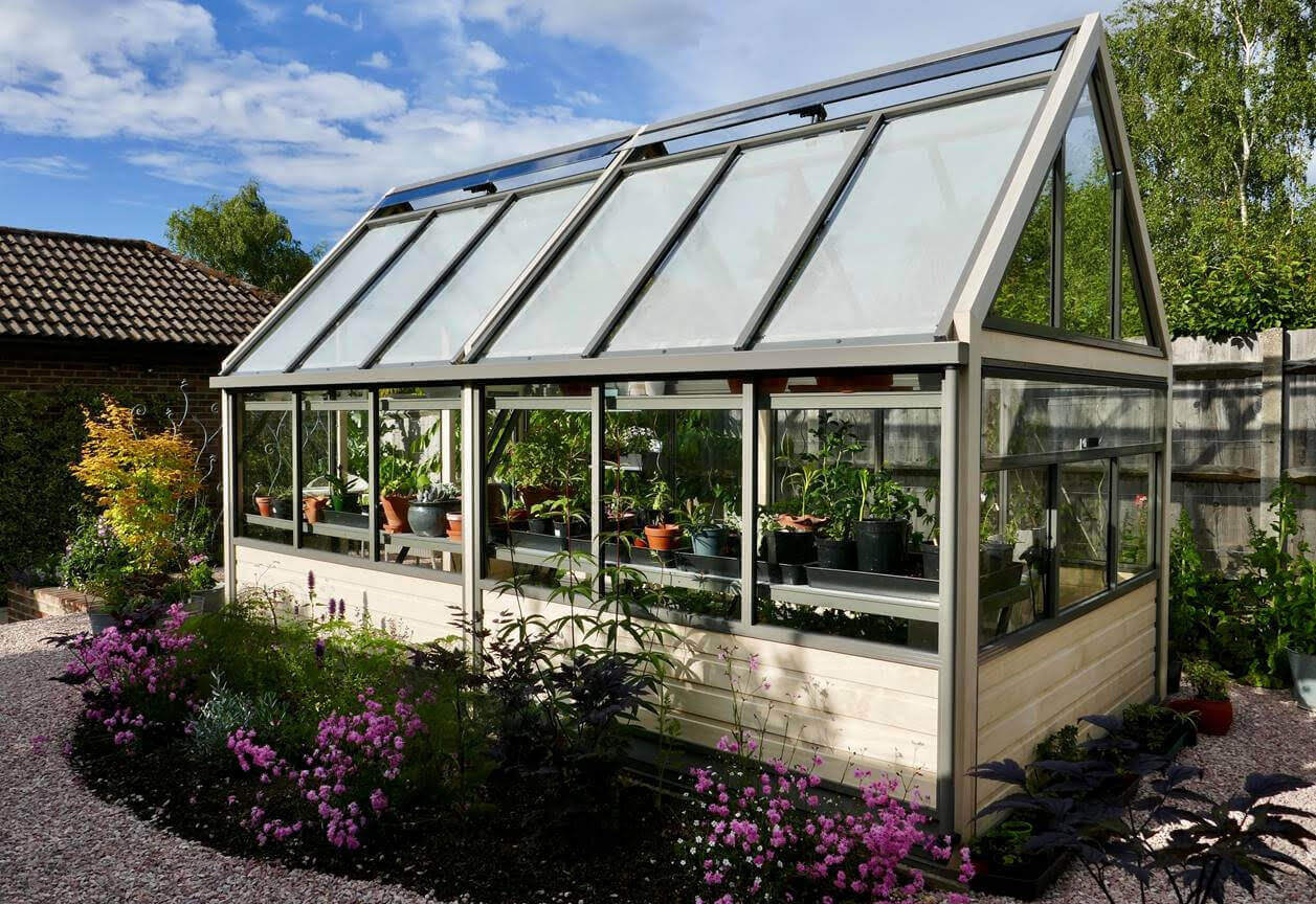 Large greenhouse with accoya boarded base panels