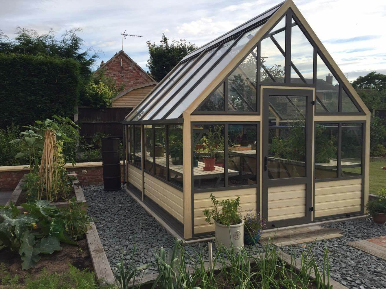 large greenhouse with wooden base