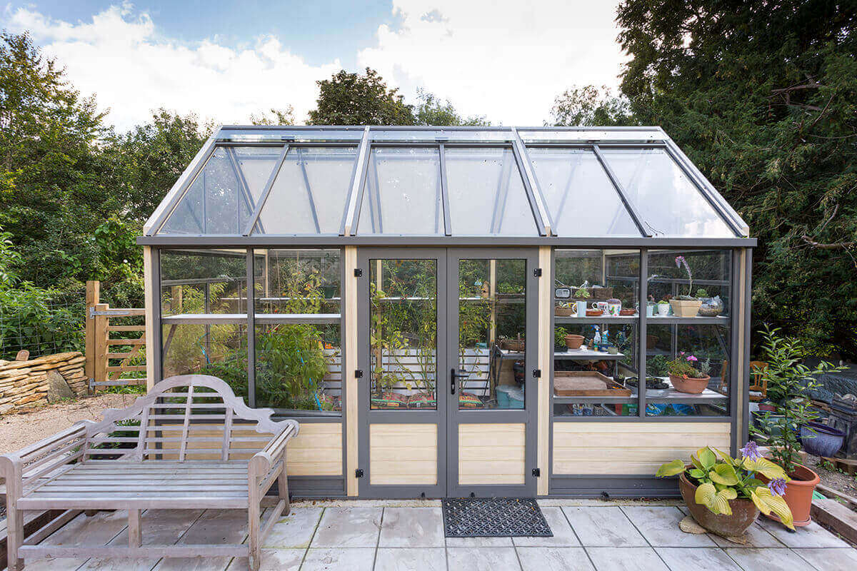 Modern accoya greenhouse in kitchen garden