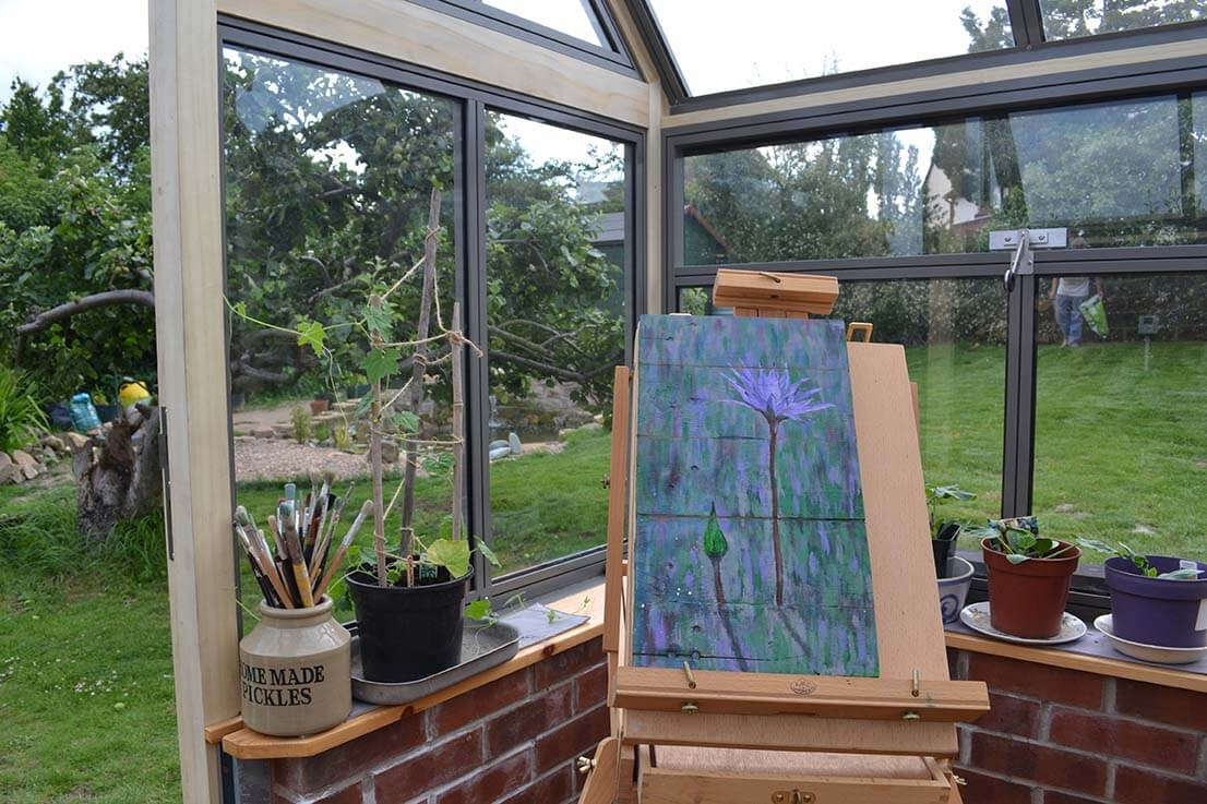 Painting in the greenhouse