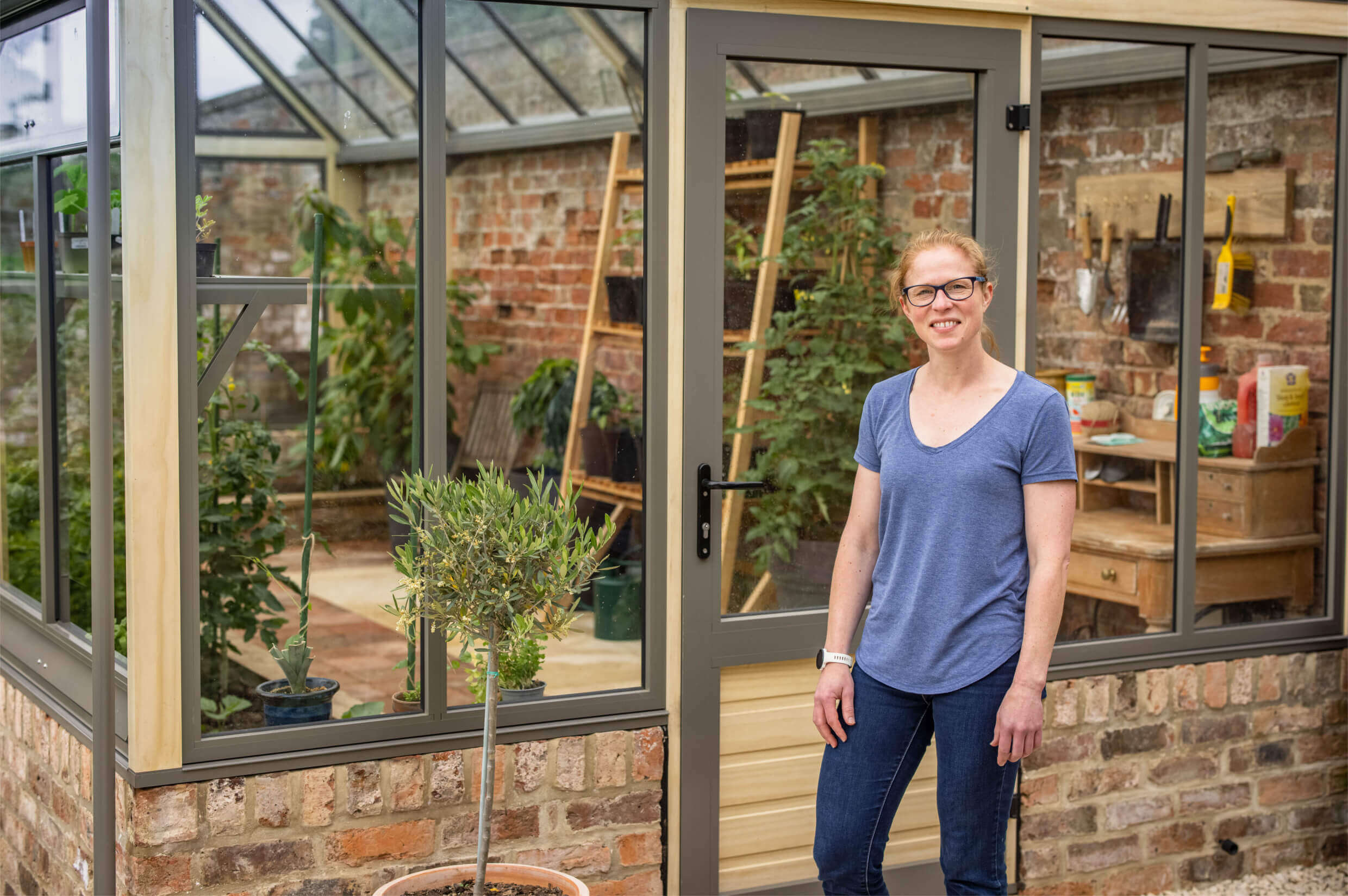proud customer in front of cultivar greenhouse
