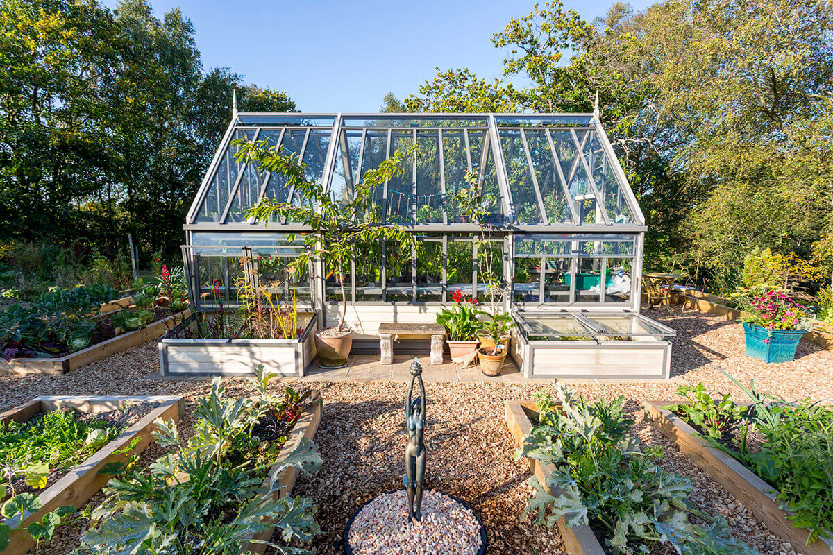 Side view of victorian greenhouse in kitchen garden