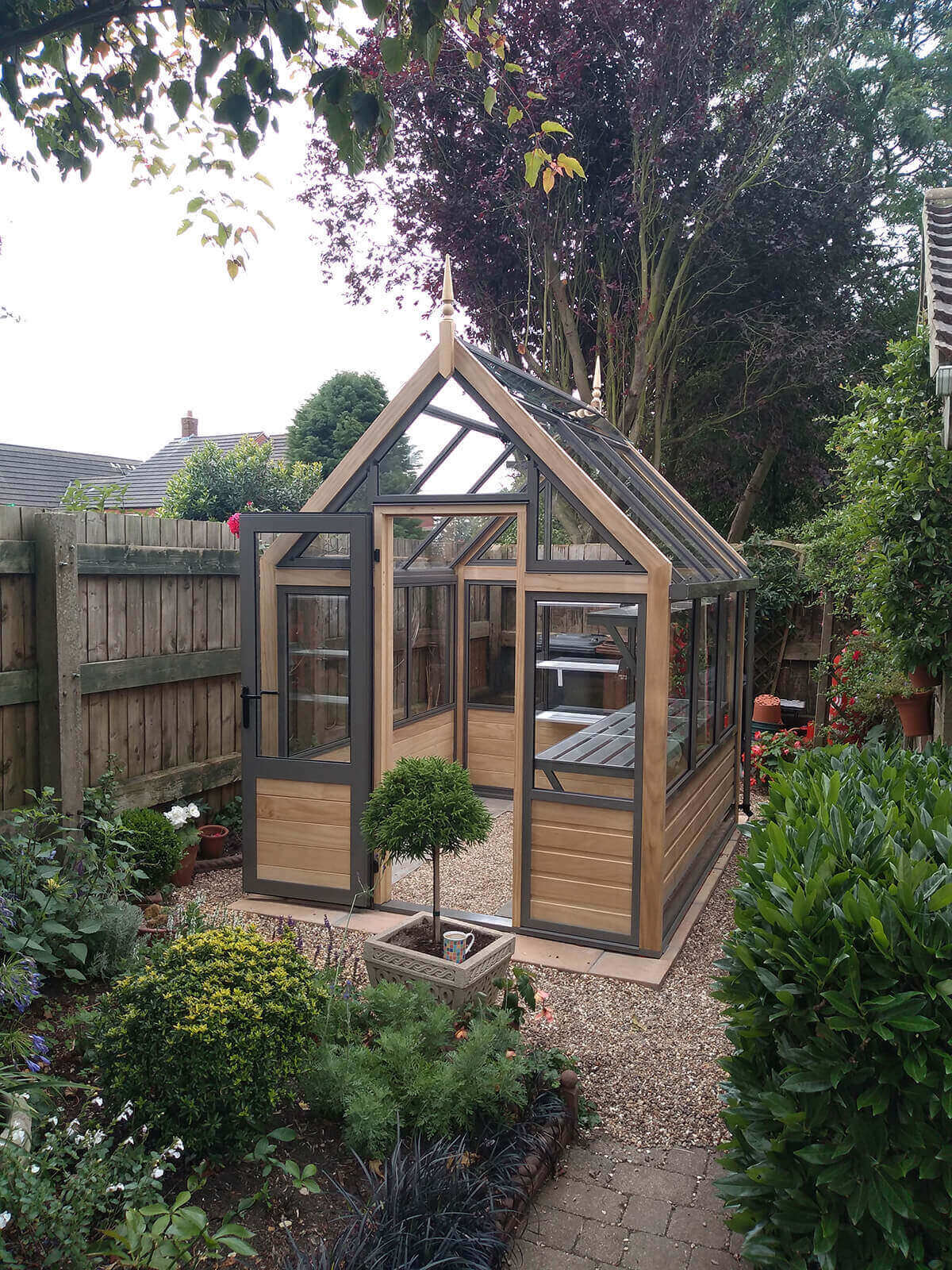 Small accoya greenhouse with finial