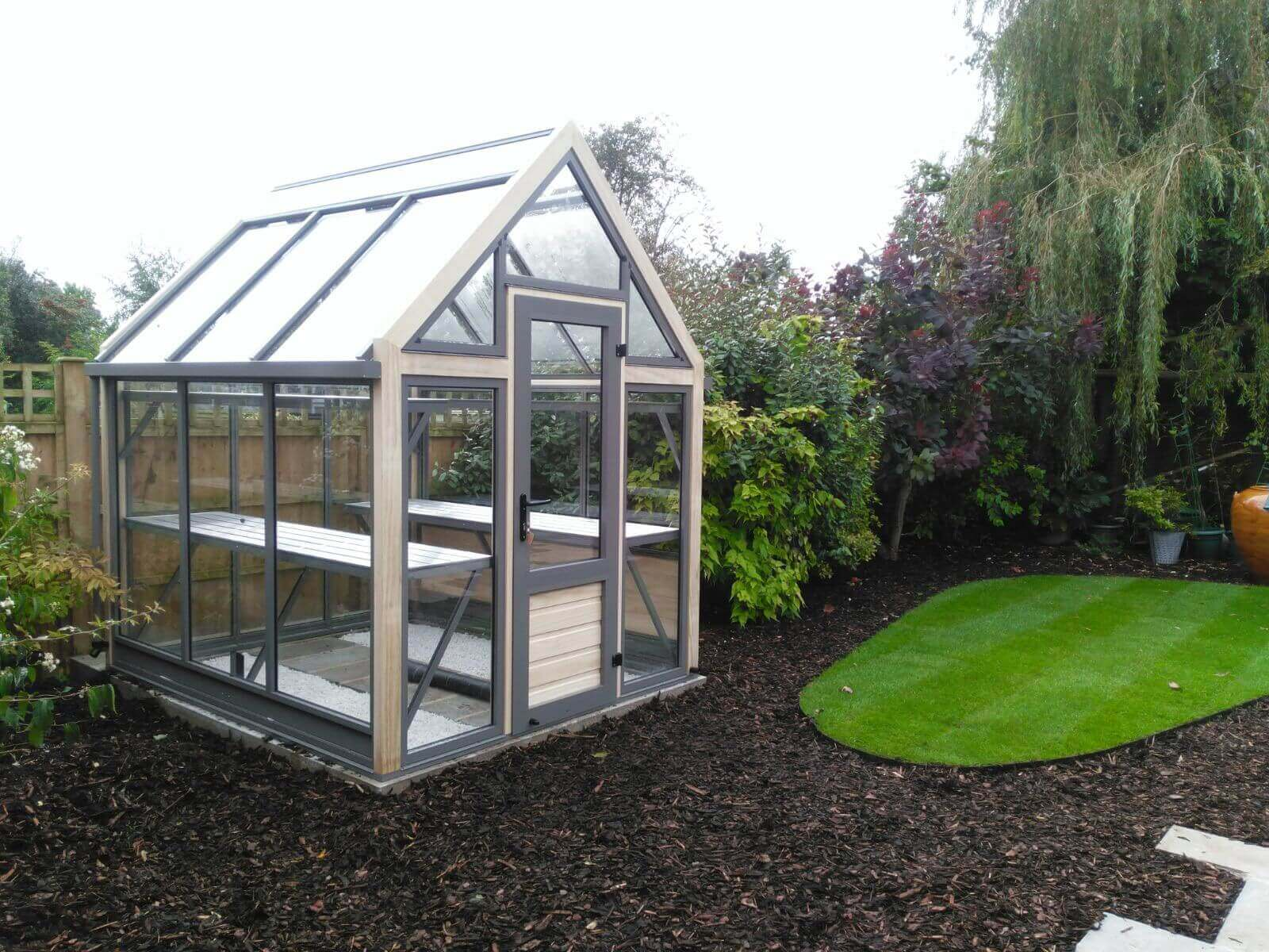 Small Greenhouse in a modern garden setting